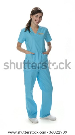 Full length view of pretty female healthcare worker standing wearing scrubs. White background.