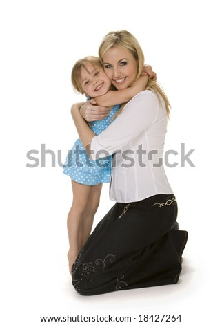 Full length view of 4 year old girl hugging her mother, shot against white background.