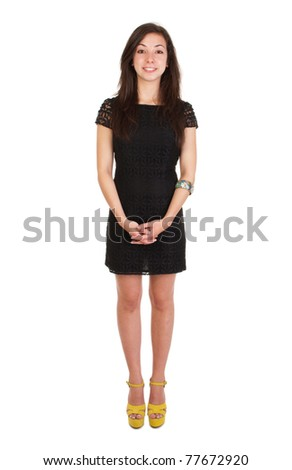 full length 18 years old young woman in black dress ready for night out (isolated on white background)