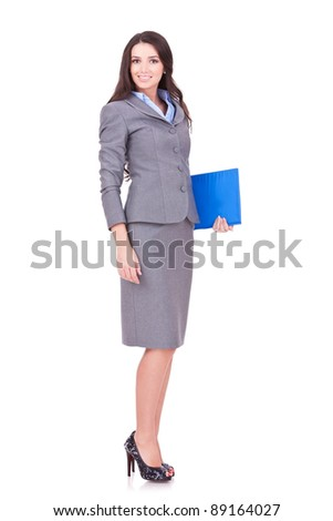 Full length young business woman standing with her clipboard isolated on white background - stock photo