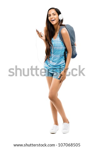 Full length young Indian teenage schoolgirl white background