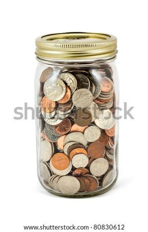 Full mason jar of change  on a white background.