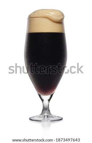 Full misted glass of black stout dark beer isolated on a white background. Stock photo ©