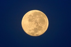 Full Moon / A full moon is the lunar phase that occurs when the Moon is completely illuminated as seen from Earth.