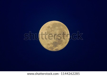 Full Moon / A full moon is the lunar phase that occurs when the Moon is completely illuminated as seen from Earth. #1144262285