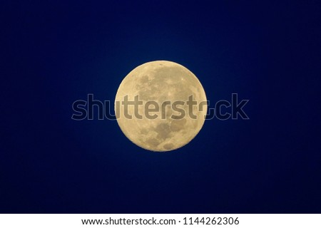 Full Moon / A full moon is the lunar phase that occurs when the Moon is completely illuminated as seen from Earth. #1144262306