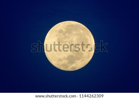 Full Moon / A full moon is the lunar phase that occurs when the Moon is completely illuminated as seen from Earth. #1144262309
