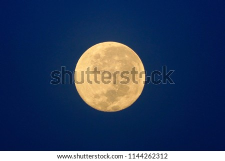 Full Moon / A full moon is the lunar phase that occurs when the Moon is completely illuminated as seen from Earth. #1144262312