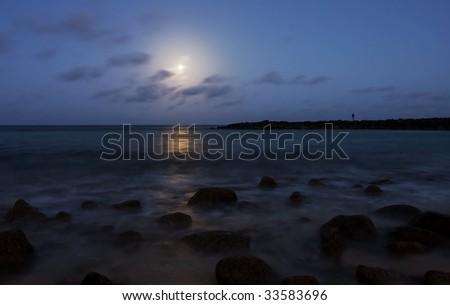 full moon above sea