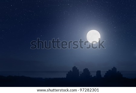 Full moon and starry sky over the city