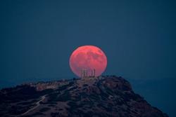 Full Moon at Ancient Temple of Poseidon - Sounio Cape - Greece