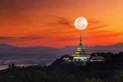 full moon background over temple in Thailand,Makha Bucha Day.