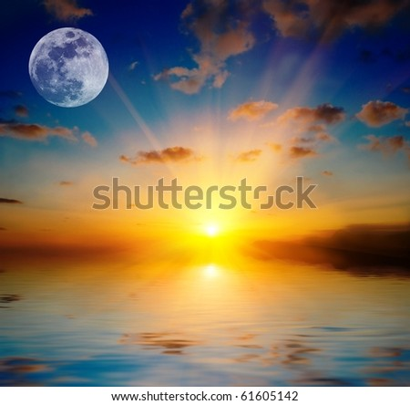 full moon by a majestic sunset above a lake