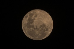 Full moon close up on night sky background, surface moon on black background and not star in sky, moon is planet of earth in univers