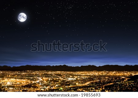 Full moon in clear star filled sky over generic urban area - landscape exterior
