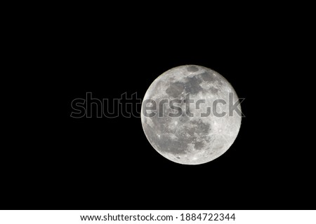Full moon in the sky of Madrid, in Spain. With a completely clear sky being able to see the completely bright moon. Horizontal photography. Сток-фото ©