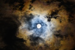 full moon night the moon is shining through the cloud