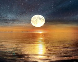 full moon on starry sky at gold sunset at sea nature landscape background