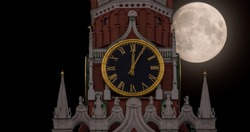 Full moon on the background of the clock of the Kremlin Spassky tower in Moscow