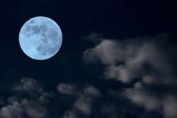 Full moon on the sky and soft blurred clouds.