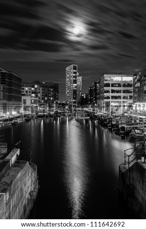 Full moon over Clarence Dock and the Royal Armouries museum in Leeds (black and white)