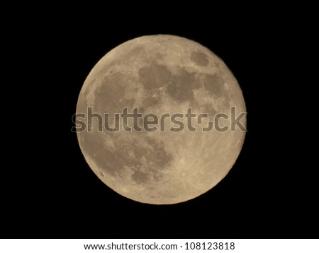 Full moon over dark black sky at night - stock photo