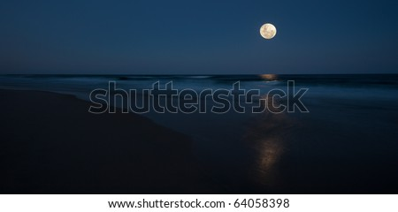 Full moon over ocean, Queensland Australia - stock photo