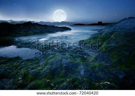 Full moon over the coast in Cornwall, UK