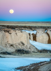 Full moon rise over prairie - Pawnee National Grassland in northern Colorado in early spring scenery