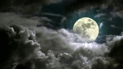 Full moon rising over cloudy cloud at night with copy space. A night panorama view of crescent moon in the night sky at midnight. A lonely night with moonlight romantic landscape background concept.