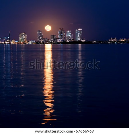 full moon rising over miami south beach on first day of winter, december 2010