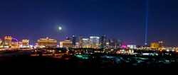 Full moon shining down on the Las Vegas Strip.