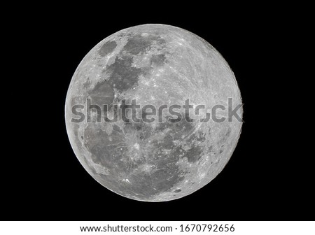 Full moon stack dark night sky. The full moon is lunar phase when It appears fully illuminated from Earth's perspective. It occurs when Earth is located between Sun and Moon appears as a circular disk