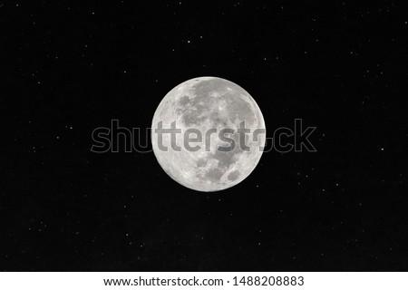 Full moon with many stars in the dark night.