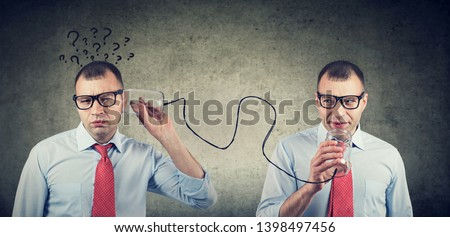 Full of doubts businessman with qirstions listening to self inner voice