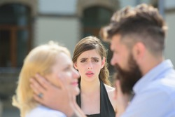 Full of jealousy. Romantic couple of man and woman dating. Jealous girl look at couple in love on street. Bearded man cheating his woman with another girlfriend. Unhappy woman feeling jealous.