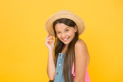 Full of joy. happy childhood. cheerful little girl wear straw hat. beach fashion for kids. small child on yellow background. holiday joy and activity. beauty. long-awaited summer vacation.