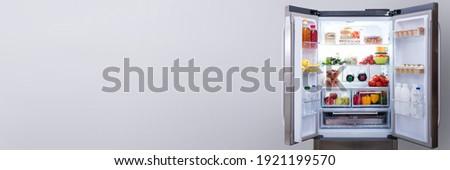 Full Open Refrigerator Or Fridge In Kitchen