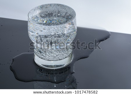 Full overflow glass with water and bubbles ストックフォト ©