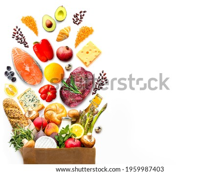Full paper bag with healthy food.Healthy food background.Supermarket food concept. World Food Day.A complete package of healthy products from the supermarket.Shopping at the supermarket.Home delivery.