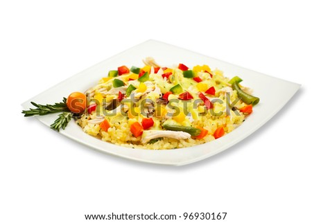 Full plateau with chicken rice and vegetables decorated with rosemary leaves