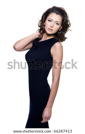 Full portrait of a beautiful adult sensuality woman in black dress posing over white background