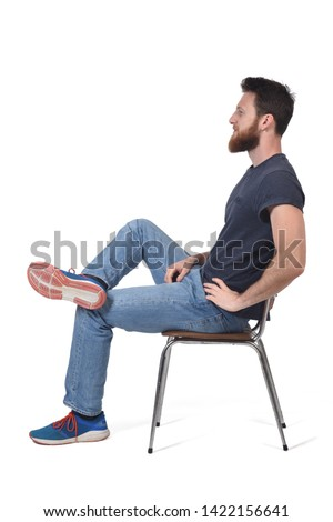 full portrait of a man sitting on a chair on white #1422156641