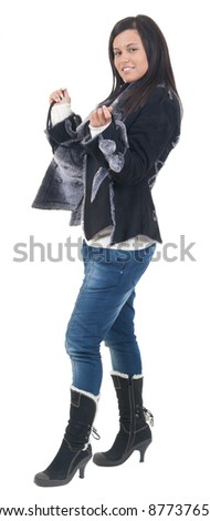 Full portrait of beautiful stylish girl in fashion stylish jeans posing - isolated on white background. Fashion model posing at studio. Full length portrait/Fashion girl
