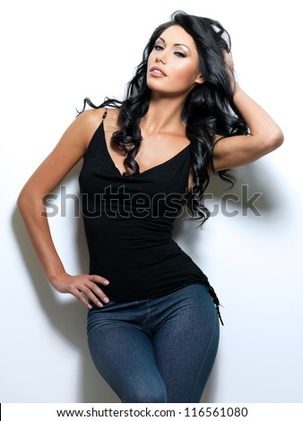 Full portrait of the woman with beauty long brown hair - posing at studio