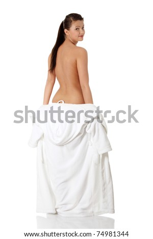 Full portrait of young beautiful woman wearing bathrobe - stock photo