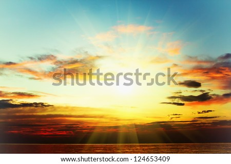 Full power sunset in the sea - stock photo