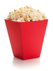 Full red bucket of popcorn, isolated on the white background, clipping path included.
