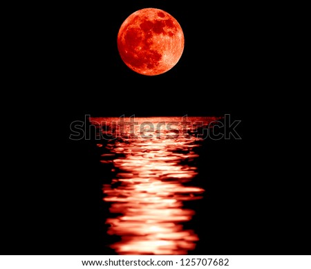 Full red moon with reflection closeup showing the details of the lunar surface.As seen from Varna,Bulgaria