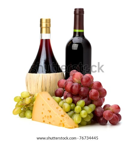 Full red wine bottles and grapes isolated on white background